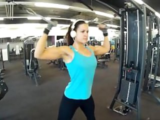 Fitness girl training biceps triceps