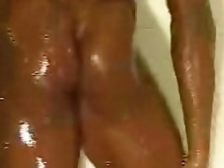 Black Female Bodybuilder taking a shower 2