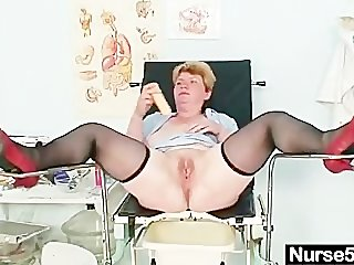 Filthy mature lady toys her hairy pussy..