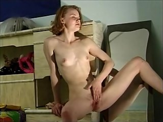 Pale Redhead with perky tits fingering..
