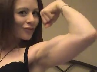 Melissa flexing her biceps