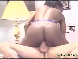 Classic ebony bitch rides white cock