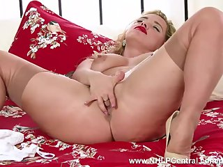 Blonde Milf Olga Cabaeva strips in retro..