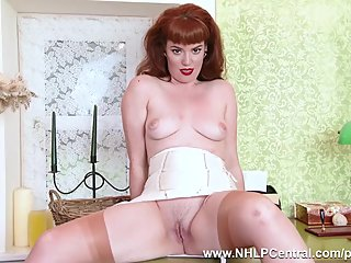 Redhead Zoe Page teases and strips..