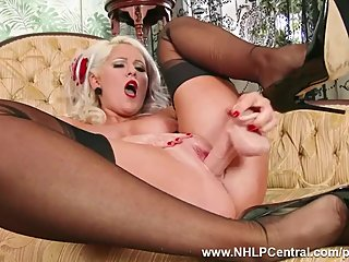Busty blonde Lu Elissa strips off retro..